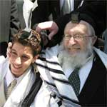 Celebrating bar mitzvah in new tefillin, teffilin, phylacteries, in Israel
